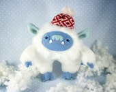 Young White Yeti in a Winter Hat with Pompom, soft art toy