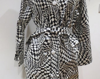 1960s black and white plastic mac  and hat op art Bridget Riley stylee Mod Swinging London chic