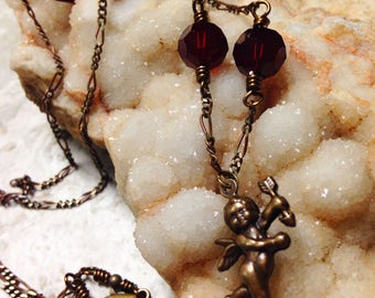 wire-wrapped cupid and red Swarovski necklace