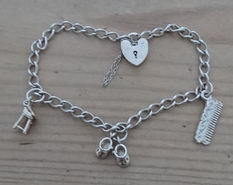 Vintage sterling silver charm bracelet with three baby themed charms