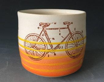 Orange Bike Cup with Yellow Stripes
