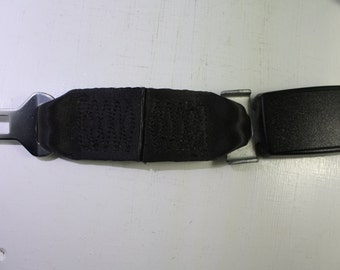 Vintage OEM GM lap belt extender.