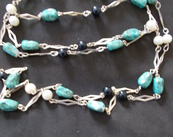 297.  Long Costume Necklace with faux turquoise and black beads and cultured pearls.
