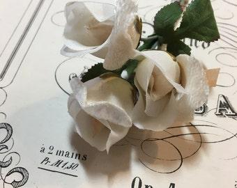 Vintage triple cream rosebud millinery flowers