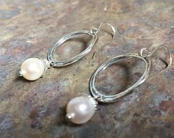 Silver hoop earrings with freshwater pearls