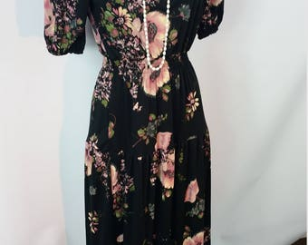 70s Black Dress. 1970's Black Floral Boho Maxi Dress. Scoop neck. Short sleeves. Floral print. Size Small to Medium