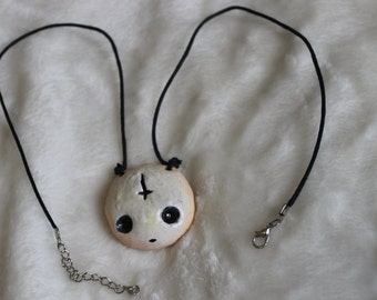 doll face necklace