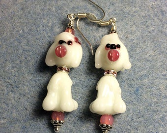 White lampwork poodle bead dangle earrings adorned with pink Czech glass beads.