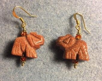 Orange goldstone gemstone elephant bead earrings adorned with orange Chinese crystal beads.