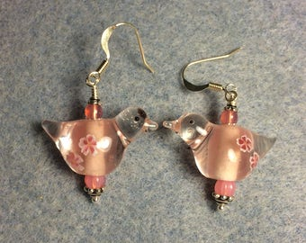 Translucent pink lampwork songbird bead earrings adorned with pink Czech glass beads.