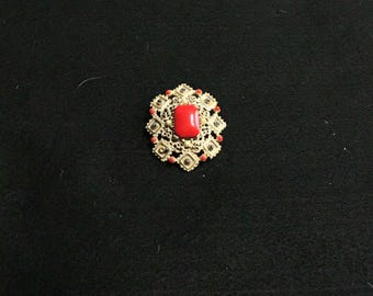 vintage gold tone enameled brooch with red stone