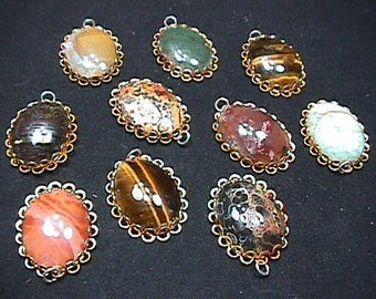 Here are 10 Cabochon Real Stones in Gold Platted Frames they are each 25 mm by 18 mm