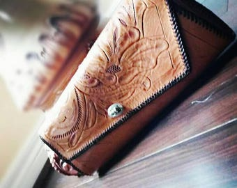 70's hand tooled leather floral clutch