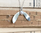 Festive sterling silver mistletoe pendant with white freshwater pearl