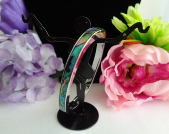 Vintage Abalone and Silvertone Cuff Style Bracelet. The Bracelet Measures 2.5 inches Long and 1/4 inch Wide.