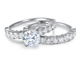 2.5 Carat 14k White Gold Forever ONE Moissanite wedding set with a a 1 Carat center Forever ONE engagement ring and moissanite wedding ring