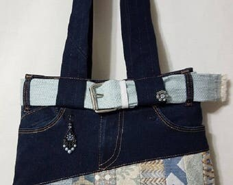 Jean Purse Fantastically put together out of Recycled Jeans with 8 total pockets 4 inside and 4 outside with zipper on top