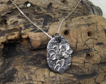 A Fine Silver Pendant with Flowers