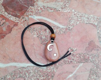Handmade pendant, with lacquered beach stone, wooden beads, silver moon and a small crystal pearl.