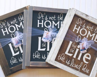 It's not the home I love but the life that is lived here Framed Wood Sign