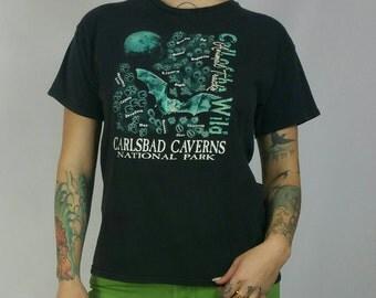 "Vintage 1990s Black Glow in the Dark Carlsbad Cavern Animal Tracks Tshirt size S/M (bust 36"")"