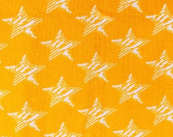 KNIT: Yellow Stars Knit Fabric. Sold by the 1/2 Yard