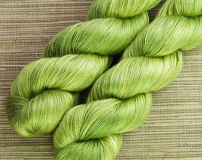 Featured listing image: Hand dyed yarn - 100g 100% Silk 4 ply/ fingering weight in 'Wasabi' - With free cowl pattern