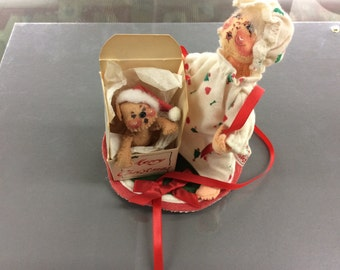 Annalee doll mother holding opened gift with bear coming out