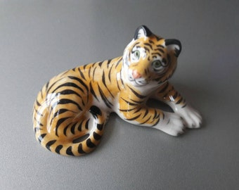 Group of Four Tigers made of Porcelain