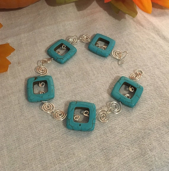 Silver and faux turquoise bead bracelet, silver swirl links