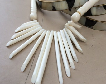 """Collection: vintage 1970's """"bone"""" bib fringe necklace with trio of mother of pearl and brass bracelets"""