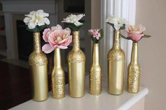 Gold wine bottles gold wine bottle centerpieces gold for Gold wine bottle centerpieces