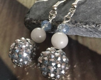 Petite silver crystal ball earring with transparent blue crystal