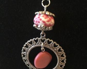 Mauve discs with circular heart pendant