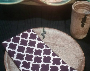 Like new set of four latticework aubergine purple printed cloth dinner napkins