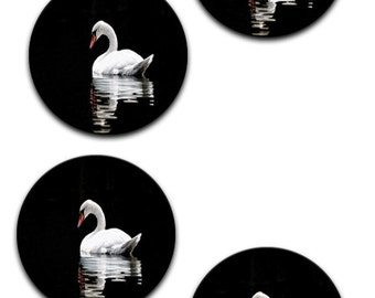 A pack of 4 of swan on black Pattern weights I deal for weighing down patterns on delicate fabrics no need for pins like TV sewing Bee
