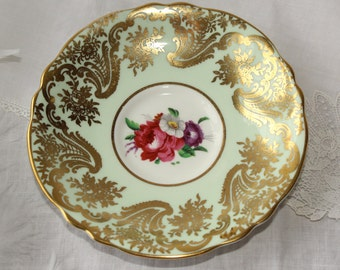 Paragon, England: Orphan green saucer with flowers