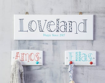 Spots and Stripes family surname sign,