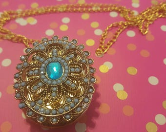 Blue and gold locket