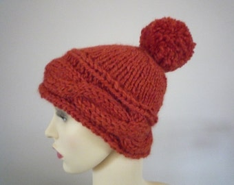Hand knit wool and alpaca dark orange cabled beanie hat with pompom