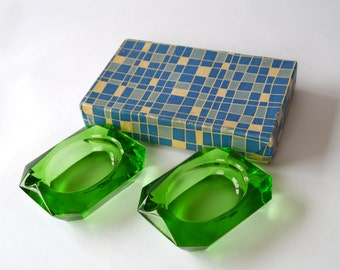 Set of two emerald green glass ashtrays, nibbles trays, trinket trays, dishes
