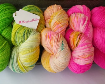 Yarn package: 2 strands of Merino silk blend, 3 skeins Merino high twist