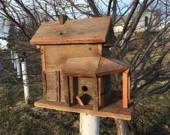 Rustic birdhouse made to look like an old house