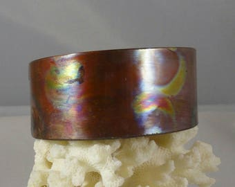Solid copper cuff,flame patina, shines like a rainbow.