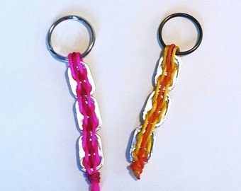 Keychain with rings of soft drinks