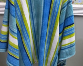 Blue green and white striped fleece poncho. Home made by Pam. in my smoke and pet free shop