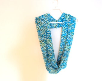 Blue infinity scarf with flower motifs. Scarf for woman summer. Accessory mode.