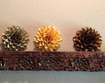 Trio of metallic flowers