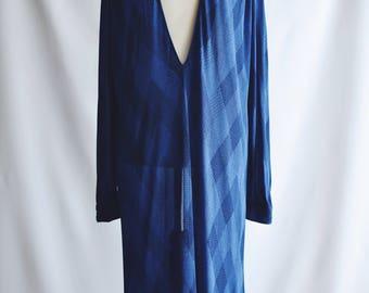Transparent blue dress.