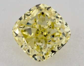 0.70 ct Cushion Fancy INTENSE Yellow natural diamond GIA certified